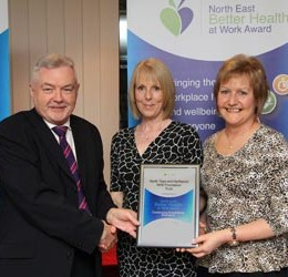 Occupational health team members receiving their excellence award