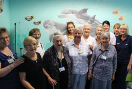 Volunteers from the League of Friends show off the newly decorated children therapy rooms