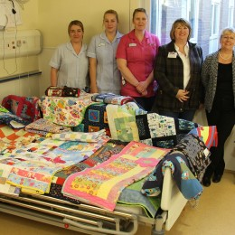 Volunteers Marjorie Cook and Irene Carter drop off their lovingly made quilts to staff in the Trusts Childrens Ward at North Tees Hospital