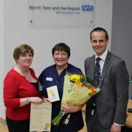 Gail, receiving her star of the month award from Julie Lane and Gary Wright