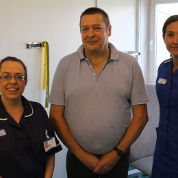 Diabetic patient Ian with staff members who helped with his treatment