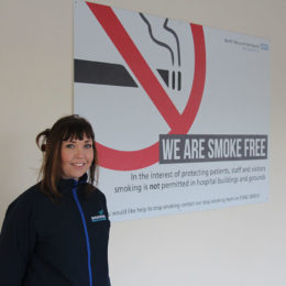 Claire Henry stood by one of the Trusts smoke free signs