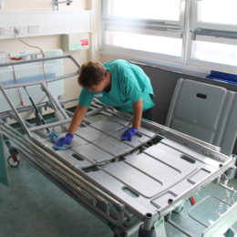 One of the trust domestics cleaning and preparing a patient bed for use on a ward