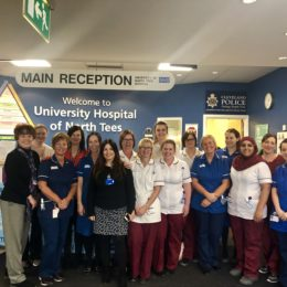 The maternity team stood in the main reception of the University Hospital of North Tees