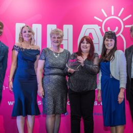 Cancer information centre accepting their team of the year award
