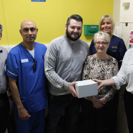 Family members Valerie and Stephen give their donation to Emergency Department staff