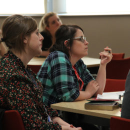 Integrated Health and Social Care Apprentices listen at event