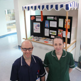 Staff members promote bowel cancer awareness in the main concourse at North Tees Hospital