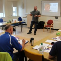 Staff actively taking part in dementia training session