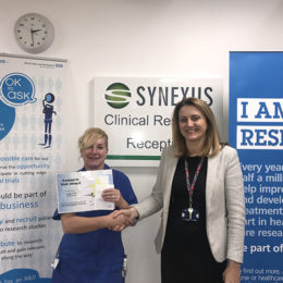 Lynda receiving the latest research star award from Jane Greenaway