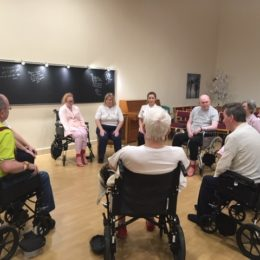 Patients sat in chapel taking part in holistic stroke rehabilitation with physiotherapist