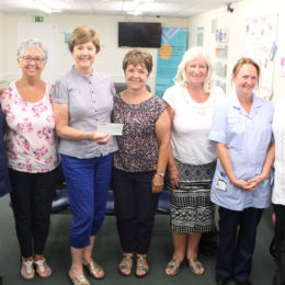 The group of friends drop off their cheque to staff members from Hartlepool main outpatients