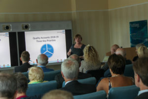 Image of Chief Nurse / Director of Patient Safety and Quality addressing visitors to the Annual General Meeting.