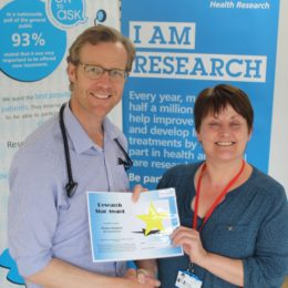 Pauline Sheppard accepts her research star award from Consultant Justin Carter