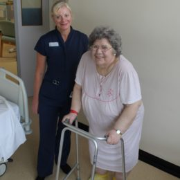 Clinical Practitioner Carole Bowler and patient Marilyn, with her new special yellow socks