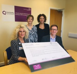 Image of staff signing the charter