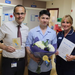 Nurse Alexandru receives his star of the month award from Ward matron Jane Corbey