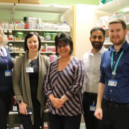 Image of a group of pharmacy staff with the deputy information and technology officer