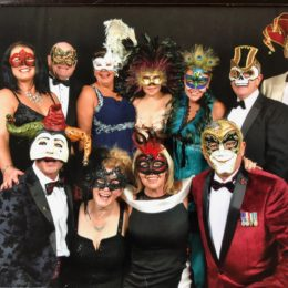 Staff enjoying masquerade ball in aid of fundraising for lung cancer