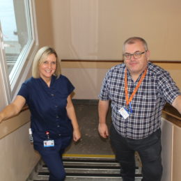Collegues take part in climb a mountain stairs challenge