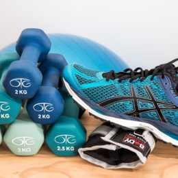 Trainers and dumbell stock image