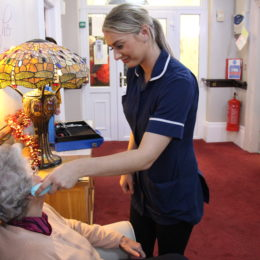 Senior-care worker Holly Golt look after a patient of White House Nursing home
