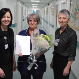 Bowel screening nurse Lorraine accepts her staff member of the month award