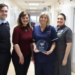 Nurse Debbie with colleagues, accepting her G.E.M award