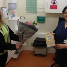 Nurse practitioner Simona McDonald receiving thank you gift from patient Veronica Taylor