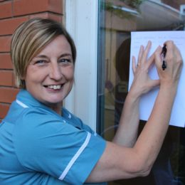 STaff member from Hartlepool Hospital signs the health letter