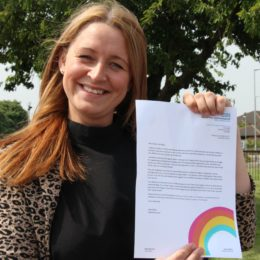 Employee Engagement colleague Kara Pickering holds up an example of the letter sent out to the loved ones as staff as a thank you, saying 'you're their super power'