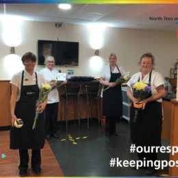 Catering staff from Hartlepool hospital seen holding flowers and chocolates