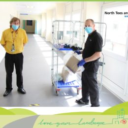 Ian Thurgood and domestic Peter French with a cage full of hospital recycling