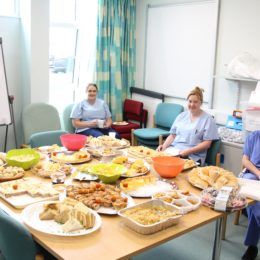 Some of the Endoscopy team sit and enjoy the team buffet in their seminar room