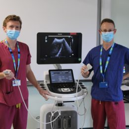 Ben Prudon and colleague show off one of the new devices helping lung healths battle against COVID-19