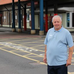 Porter Dicky Peacock stands on pavement outside of the Accident and Emergency department at North Tees
