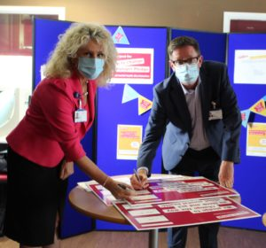 Image of Julie Gillon, Chief Executive and Alan Sheppard, Chief People Officer signing the Time to Change pledge