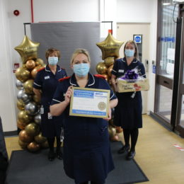 Maternity team stand with their gold standard certificates, outside of North Tees lecture theatre