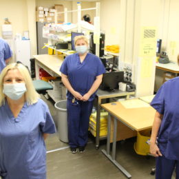 Group photograph of the aseptic pharmacy team from within their department