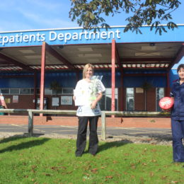 Rebecca McKenna stood outside of hartlepool hospital accepting her star of the month award