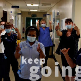 Staff members stood on ward giving the thumbs up gesture