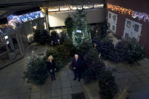 Julie Gillon, chief executive of North Tees and Hartlepool NHS Foundation Trust and Councillor Bob Cook, leader of Stockton-on-Tees Borough Council with the 'rainbow' Christmas trees.