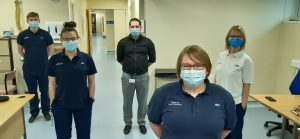 The physiotherapy team standing in a patient room at Hartlepool hospital.