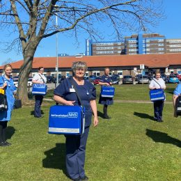 District nurses holding the special community kitbags they use on patient visits.