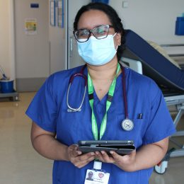 A doctor in training stood with the new tablet for paper free auditing