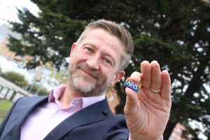 Levi Buckley, North Tees and Hartlepool NHS Foundation Trust chief operating officer with a rainbow badge