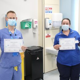 Dr Ben Prudon and research nurse Alex Ramshaw with their awards for research