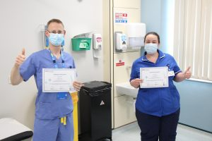 Dr Ben Prudon and research nurse Alex Ramshaw with their awards for research.