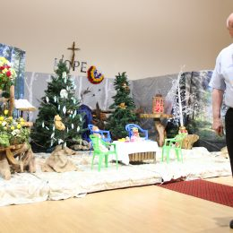 Chaplain Dave Russon in front of memorial teddy display