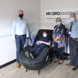 Ian Donley donating HydroMassage Chair to Trust